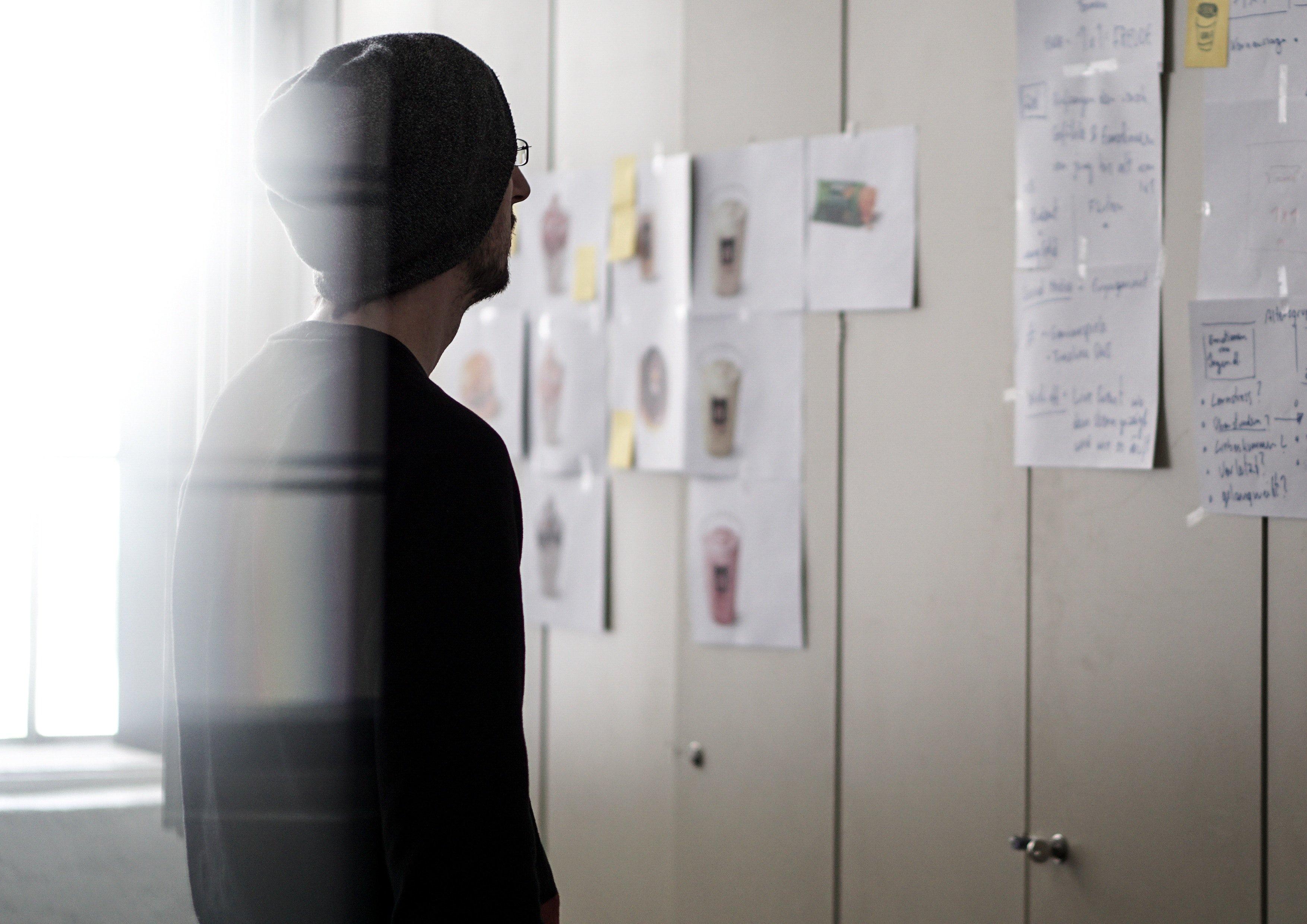 Man looking at wall of ideas