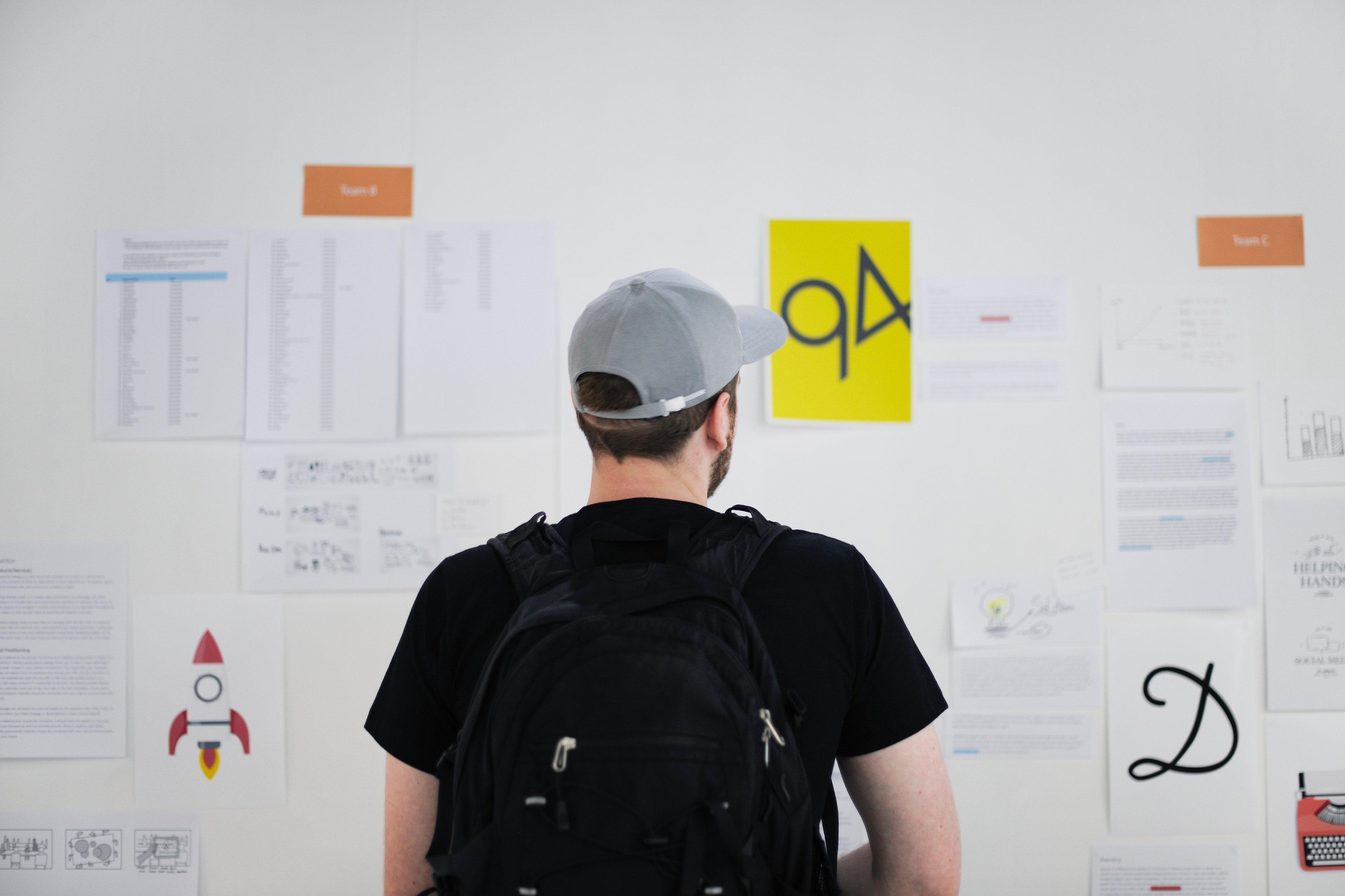 man looking at brainstorm wall