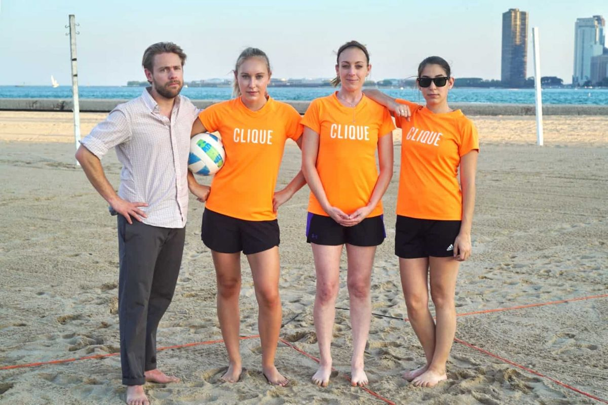 Clique team playing beach volleyball
