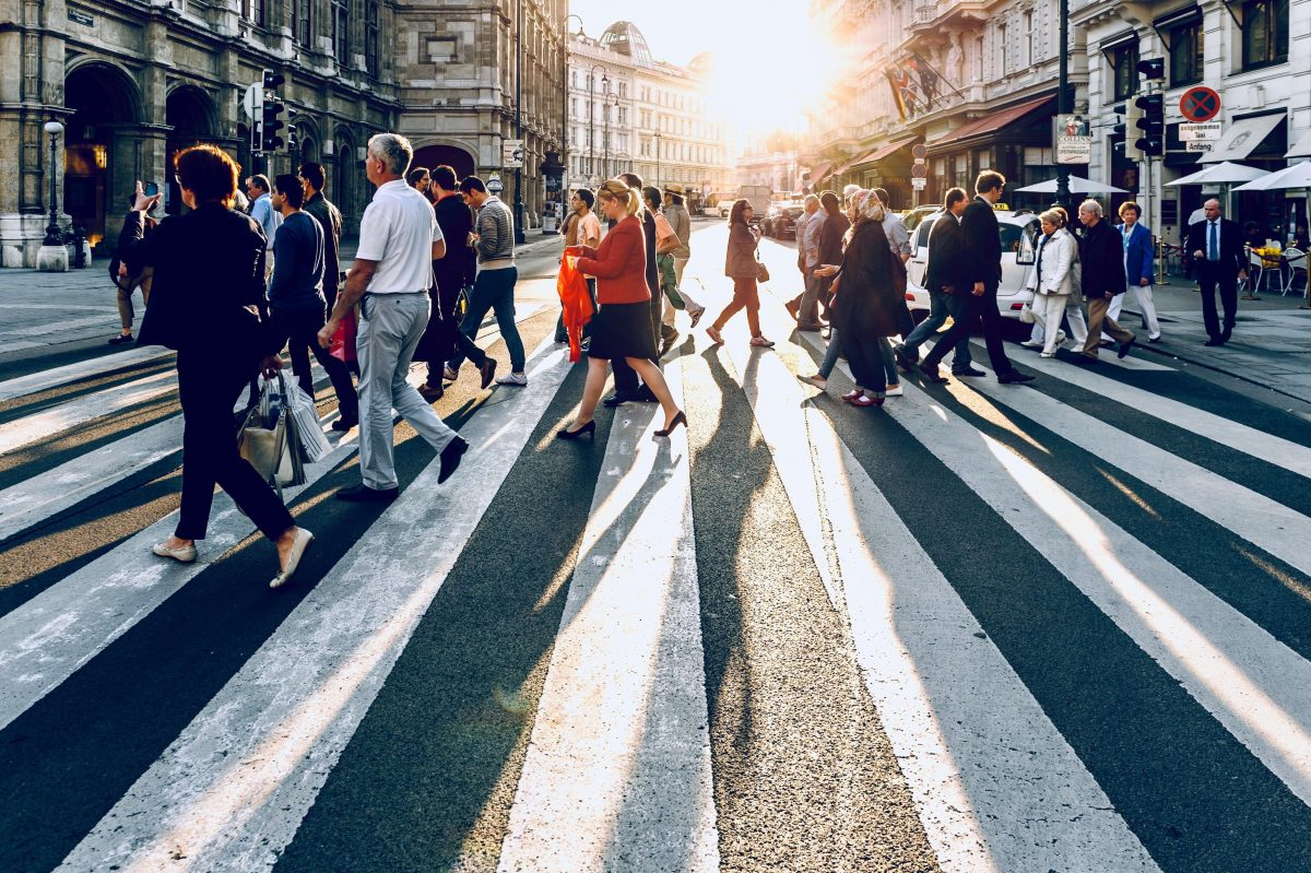 crowd of people crossing the street