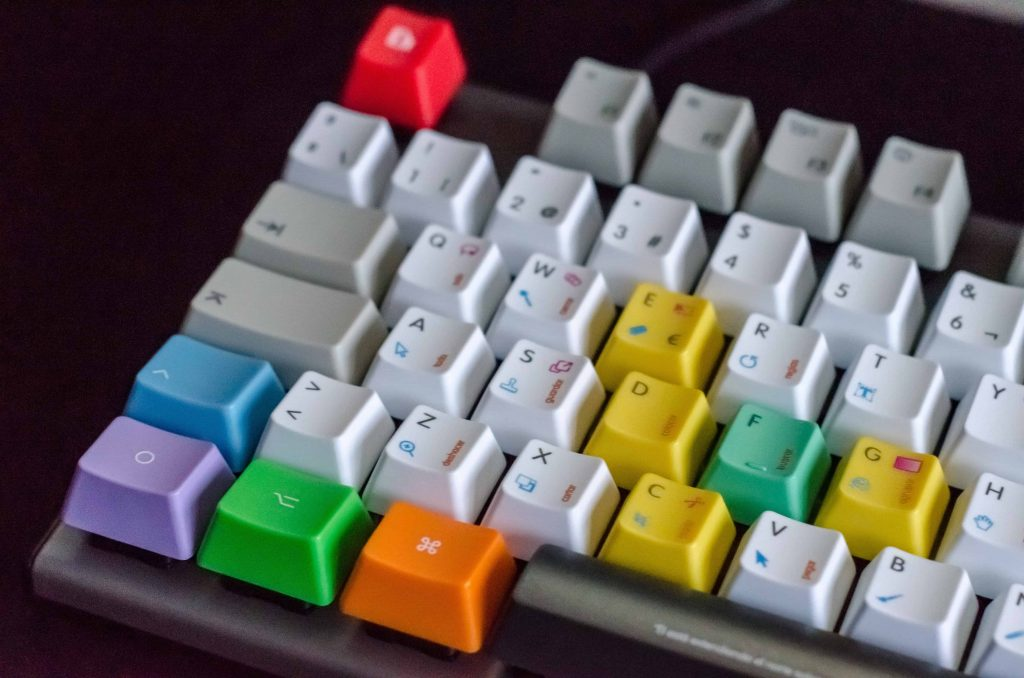 a tactile keyboard with raised and color coded keys