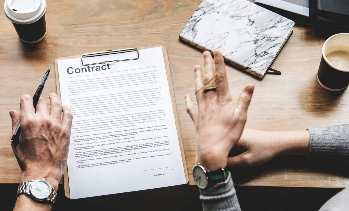 two people sitting with a contract