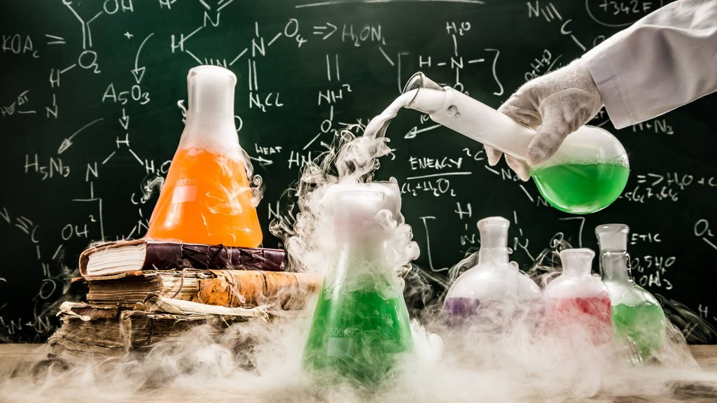 beakers with green and orange liquids