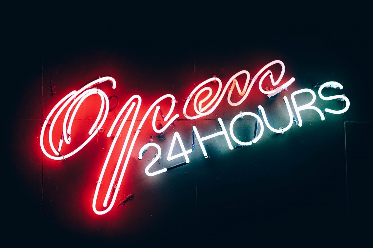 """neon sign that says """"Open 24 hours"""""""