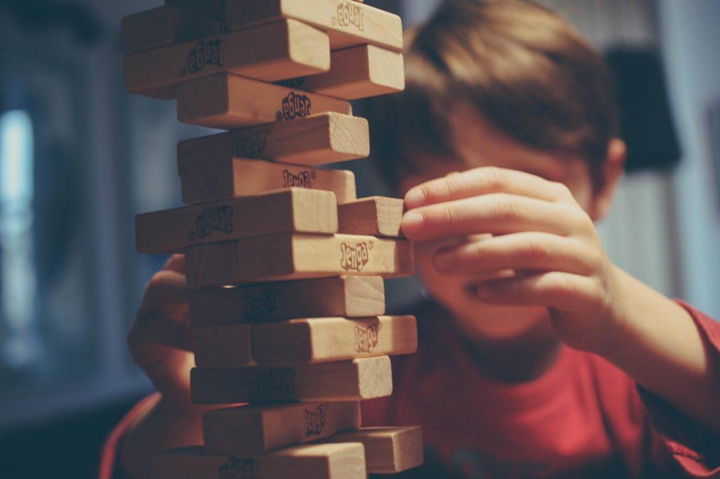 kid playing jenga