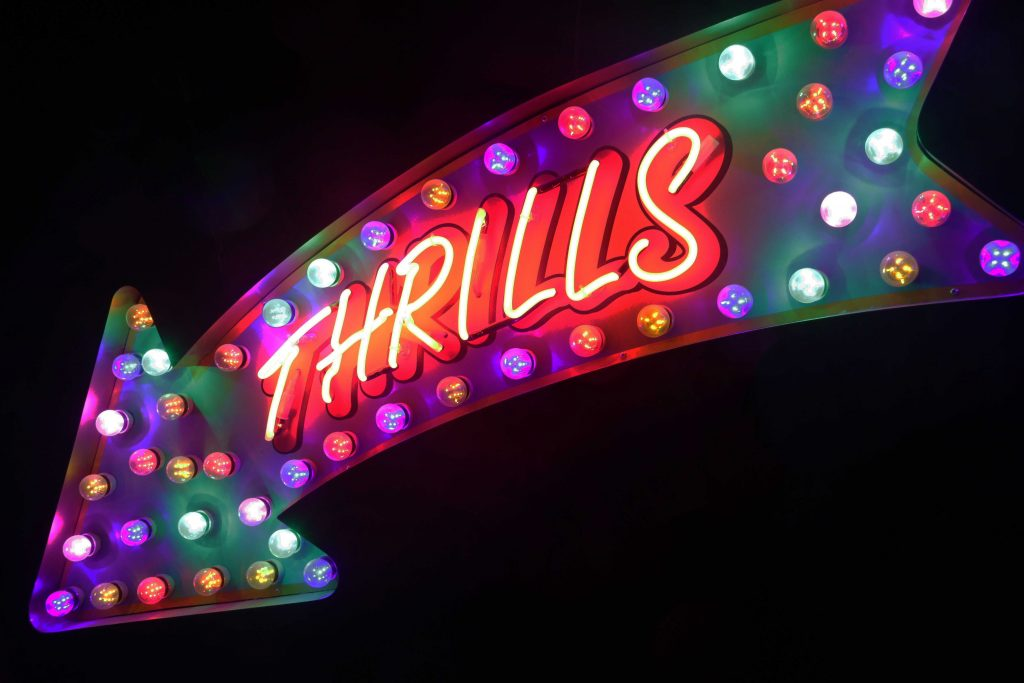 "Neon sign saying ""Thrills"""