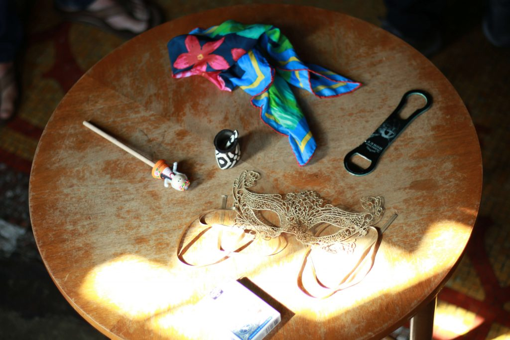 wooden table filled with miscellaneous objects