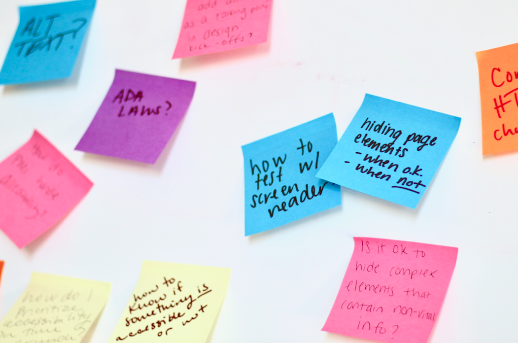 sticky notes with writing on a whiteboard