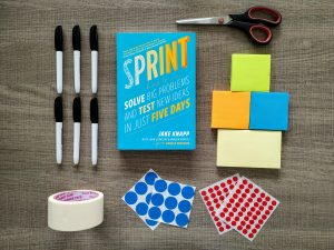 Design sprint book with materials for workshop