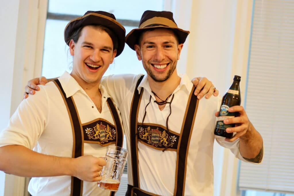 Daniel and Kyle in lederhosen with beer