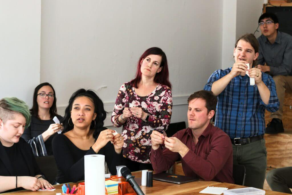 group of people looking confused