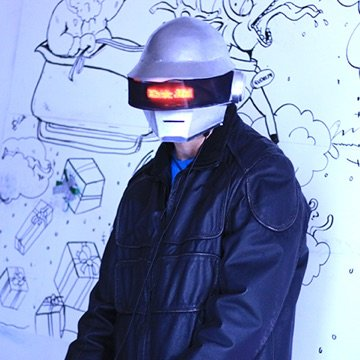 Partner playing music in a leather jacket and Daft Punk helment