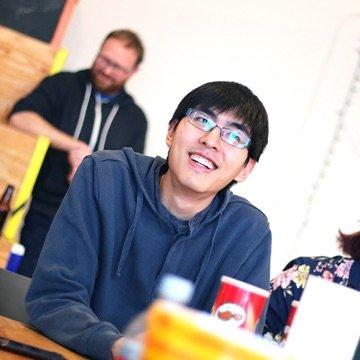 Designer smiling at a group meeting