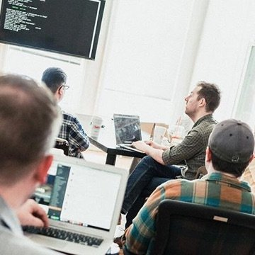 Developers collaborating in a meeting