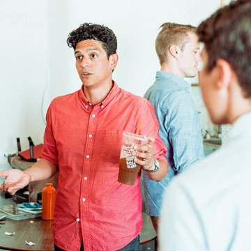 Clique team member engaged in conversation at a networking event