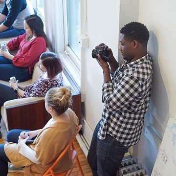 Strategist taking photos at a company gathering