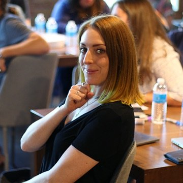 Project manager smiling at a company event