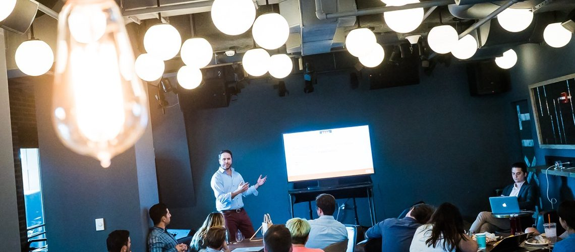 Clique partner presenting to a group