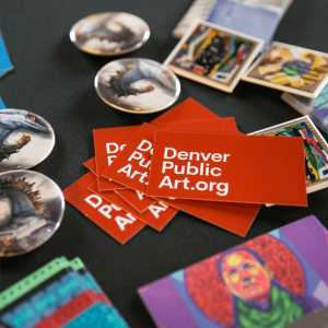 Denver Public Art .org brochures on a table with other pamphlets