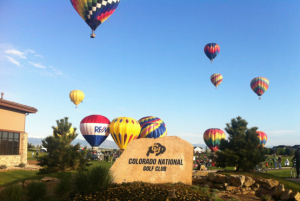 Colorado national golf club with air balloons taking off in background