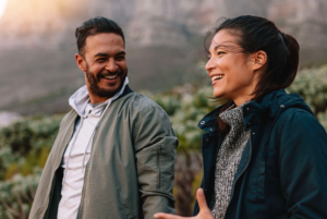 Two people laughing in the outdoors