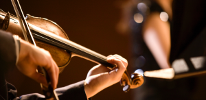 Close up of person playing violin