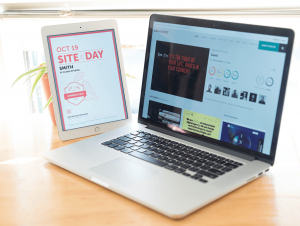 A computer and tablet showcasing awards websites