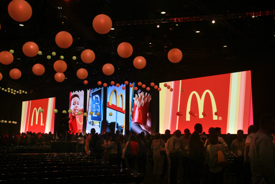 Hundreds of attendees in a conference room at McDonald's Worldwide