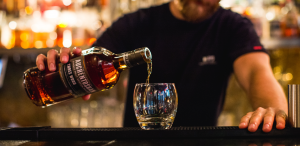 Bartender pouring Auchentoshan whisky into glass