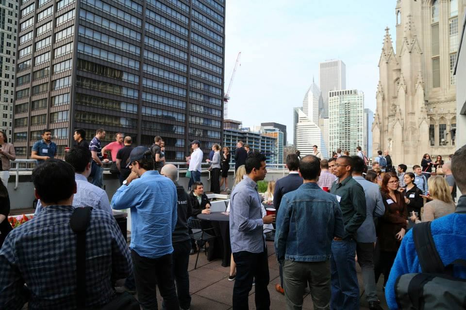 people networking at a BuiltIn Brews event at GrubHub