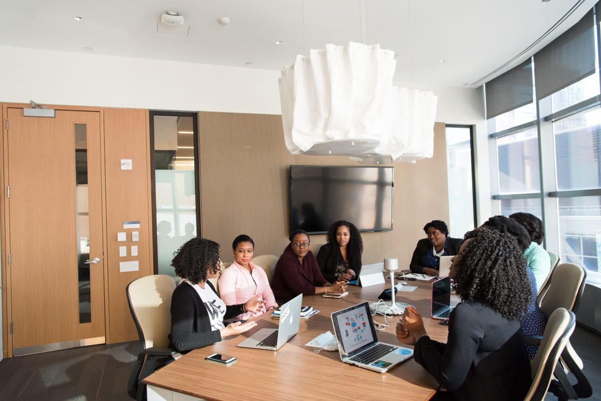 group of people having a conversation in a conference room