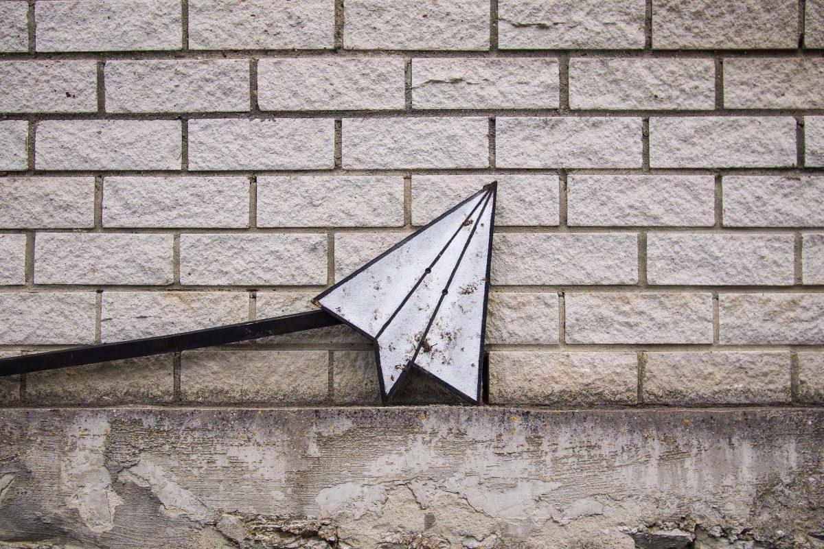 paper airplane metal art