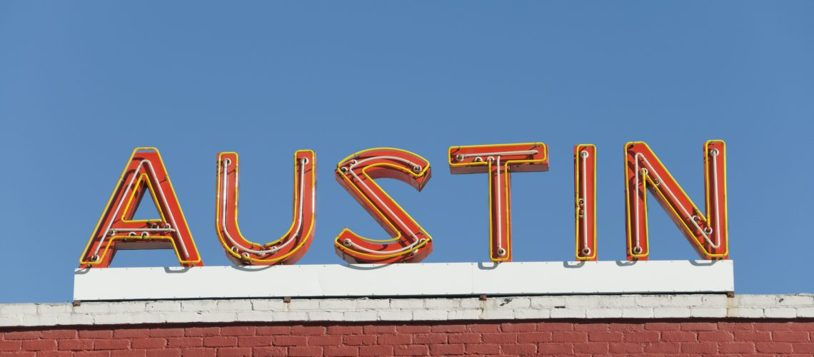 "orange neon sign reads, ""Austin"""