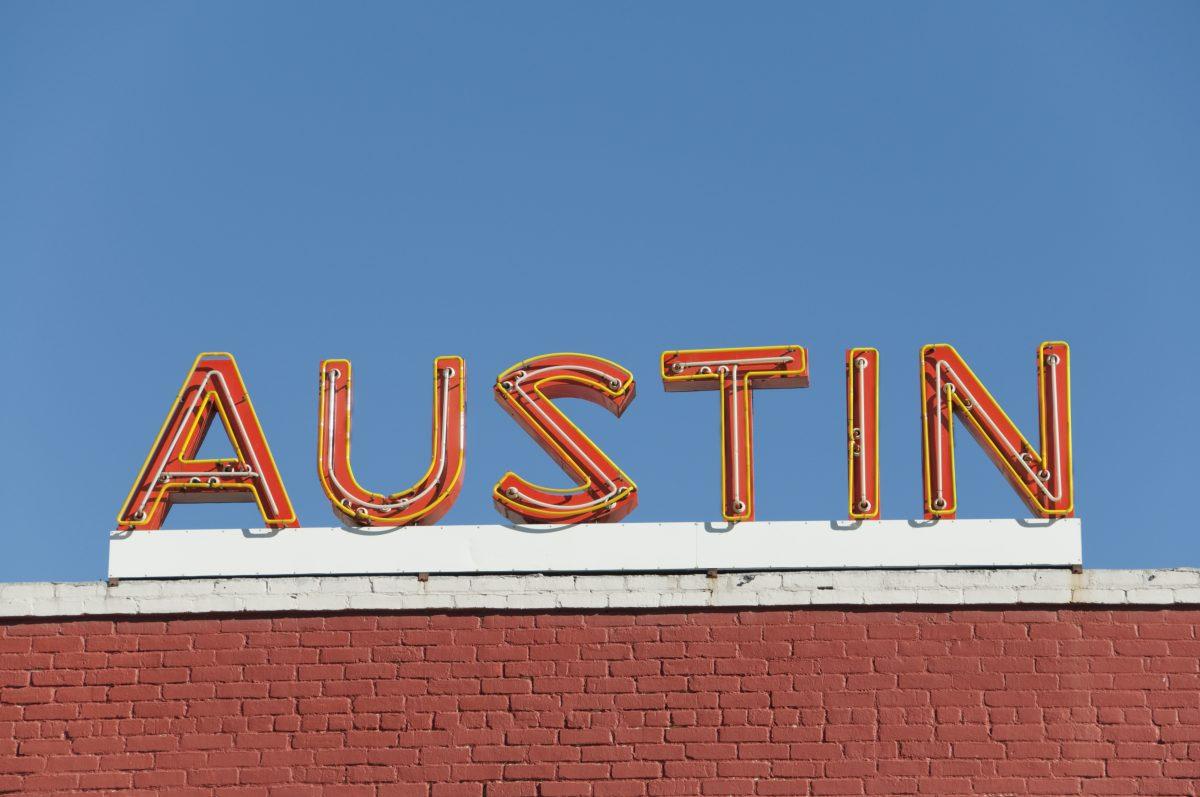 """orange neon sign reads, """"Austin"""""""